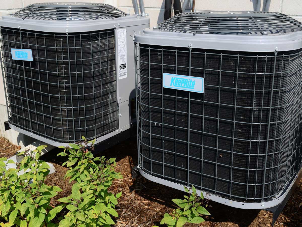 two HVAC systems outside residential house