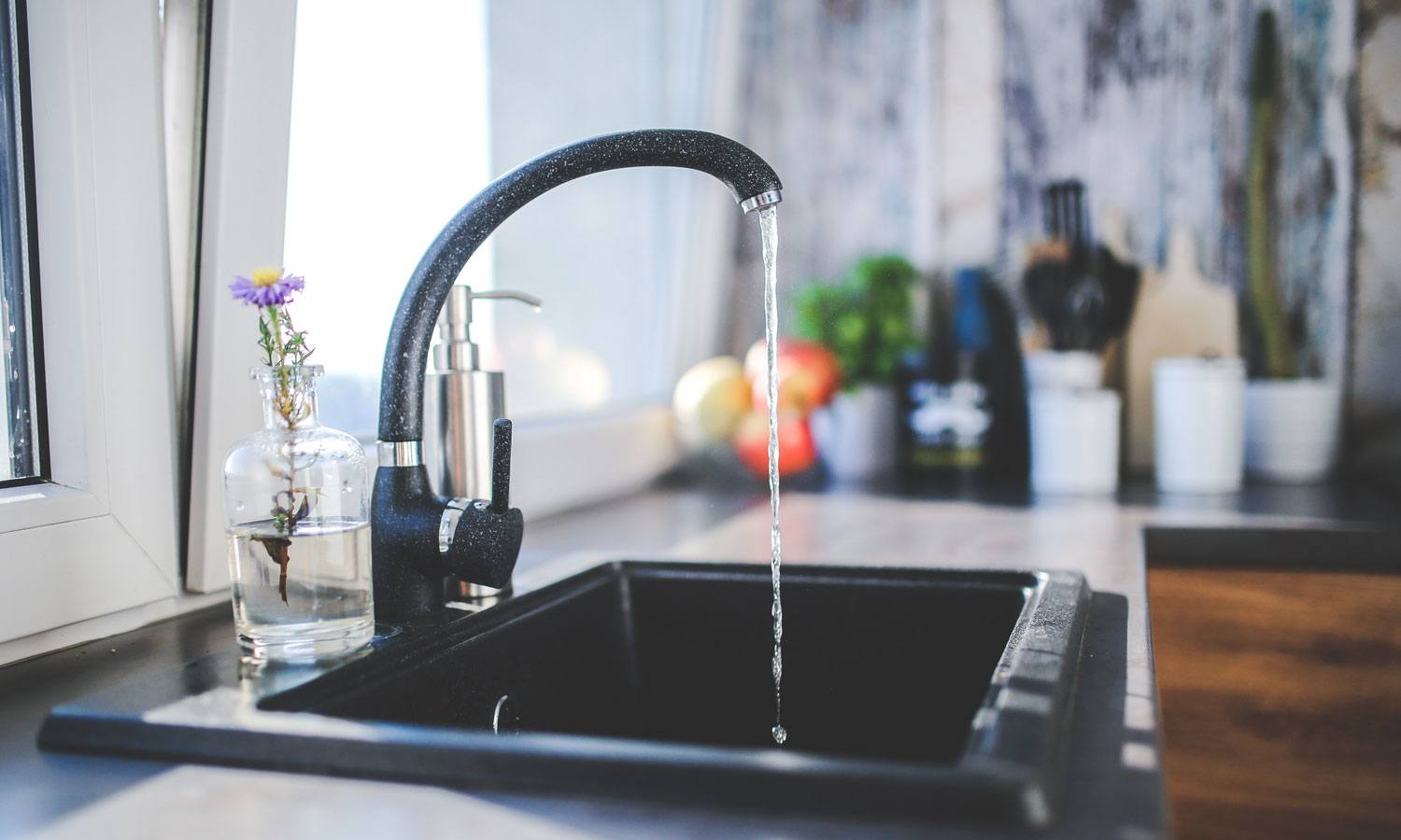 running faucet in kitchen